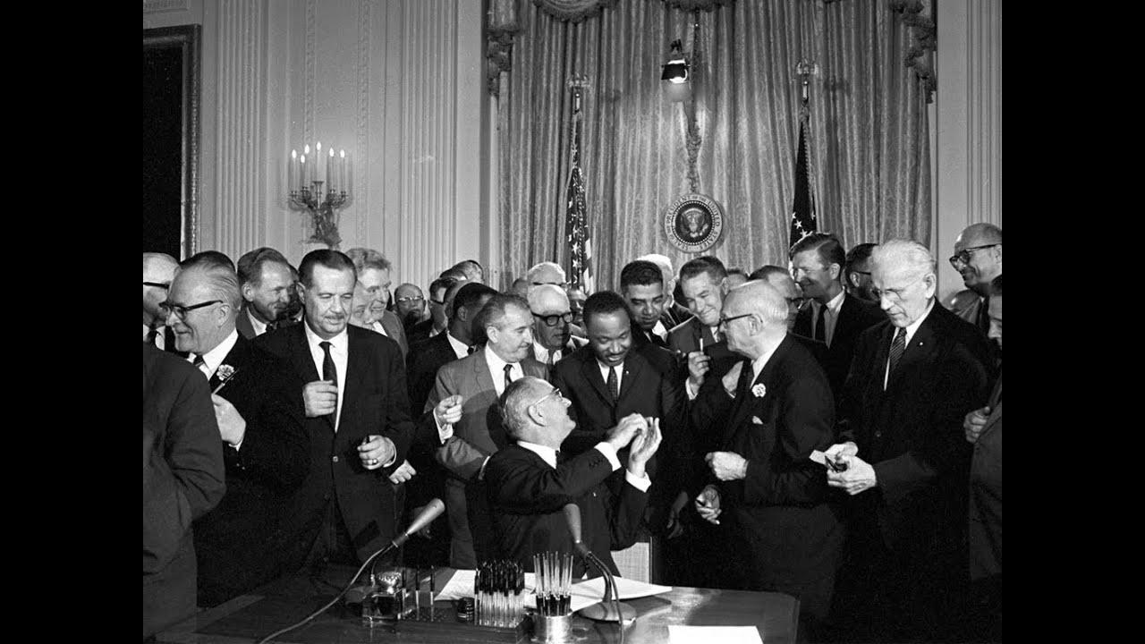 LBJ handing pen to MLK - July 2, 1964